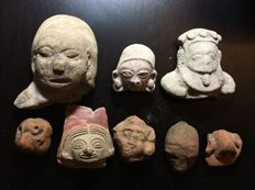 A group of eight Pre-Columbian pottery figurines heads - (8)