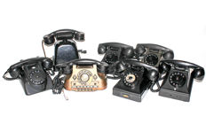 Seven different vintage and decorative telephones