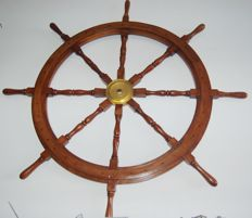 Heavy ship's wheel diam. 120 cm. in solid teak and brass,  collectible or piece of furniture.