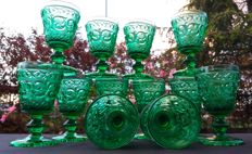 Lot of 12 green glass glasses, decorated in relief