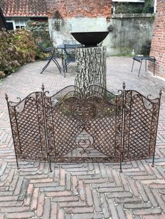 Graceful wrought-iron fireplace screen, 20th century