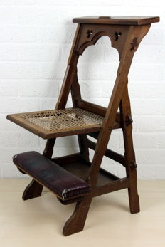 Oak prayer seat with leather upholstery and wicker seat