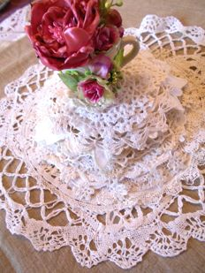 Beautiful lot of 42 vintage doilies with lovely complimentary flower cup