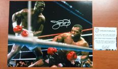 James Buster Douglas Signed 25.5x20.5 cms Mike Tyson K.O. , Photo with certificate of authenticity