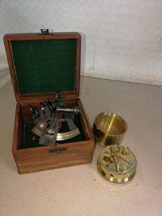 Pair of sextants, one in brass and mahogany wood, one with Kelvin & Hughes box, working. English