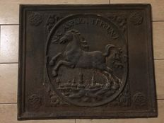 Cast iron plate for fireplace, depicting a running horse