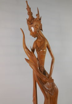 Top wood carving of the rice goddess Dewi Sri - Bali, Indonesia, around 1950