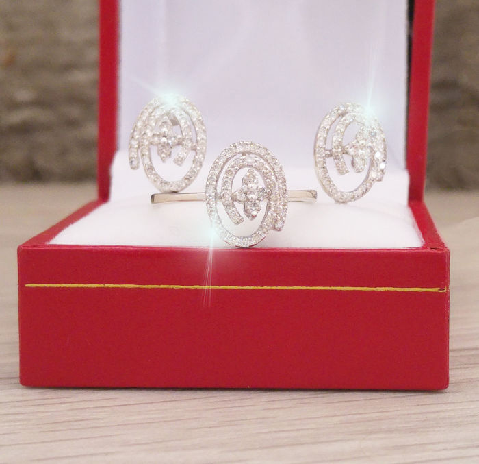 earrings and ring in white gold and diamonds E VVS1 VVS2