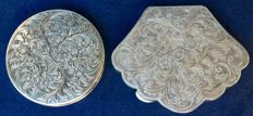 Two decorated compact powder cases, Italian decorated silver - early 1900