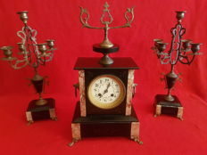 French clock, Napoleon III, from the year 1900, in black marble with two accompanying five-armed candelabras