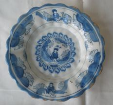 Rare 17th century pleated Delft plate with a Chinese person