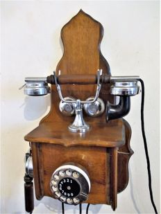 Antique model wall phone in oak, France, approx. 1970