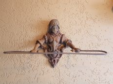 Beautiful nostalgic cast iron towel rack of a woman in old traditional costume