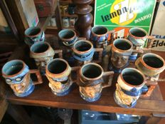 12 Cups with Faces by Capodimonte