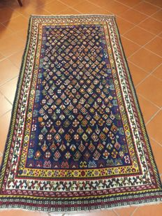 Antique Ghendje Caucasian rug in good state of preservation; good Ghiordesh knotting; shiny wools; bright colours; dimensions:  124 x 256 cm