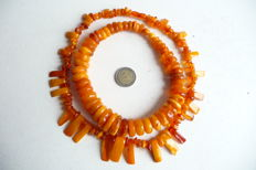 Two necklaces of old Baltic amber, old honey / toffee / egg yolk colour, 125 g.
