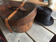 Antique hat box with a hat