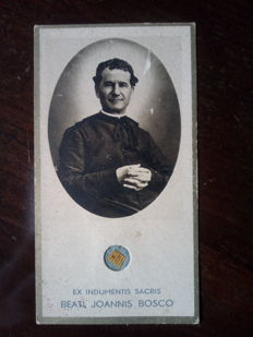 Relic of St. John Bosco + antique holy cards and ex-voto to the Madonna