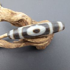 Antique Agate dZi bead from Tibet. 56.8 x 13 mm.