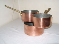 A set of 3 large French copper pans