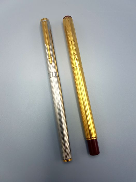 2 parker pens gold and silver