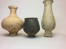 Three Roman pottery pieces - 1. - height 12 cm / 2. height 7 cm / 3. - height 14 cm (3)