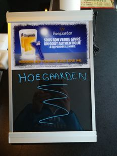 Hoegaarden illuminated sign, serves as a writing board
