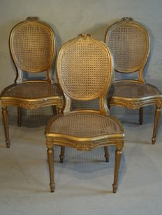 Set of three richly carved and painted Louis XVI chairs - France - circa 1770-1780
