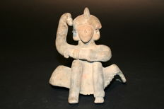 Original ceramic pre-Columbian archaeological find  Pacific Coast Man sitting with arm raised. Height mm 140