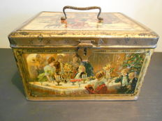 Antique biscuit tin with nostalgic Christmas images