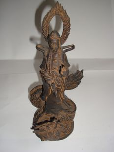 A metal alloy -bronze and silver -Late Ming ,Chinese Guanyin on dragon stand - 245 mm