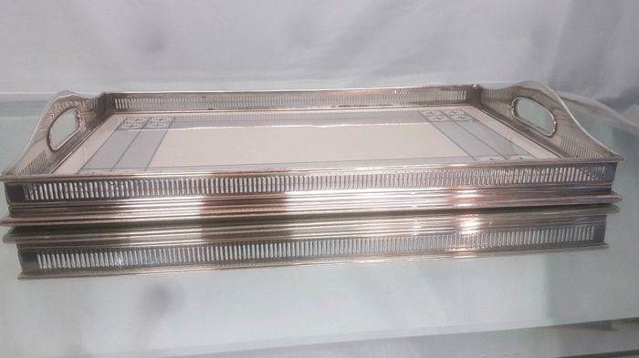 Silver plated tray with openwork decoration and ceramic base