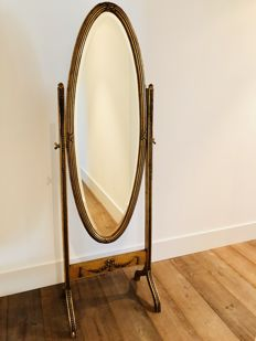 A gold-plated standing mirror in neoclassical style, 20th century