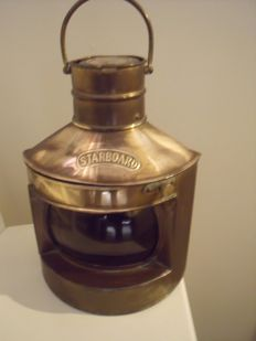 Copper and brass oil lamps starboard and port