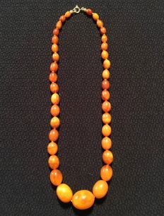 Antique amber necklace consisting of 100% natural orange egg yolk amber with 14 kt gold clasp, Germany circa 1950