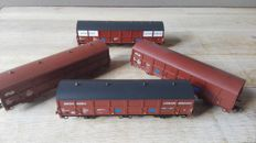 Roco H0 - 46337/46342/47608-47609 - Four long Roco closed freight cars from a.o. Oranjeboom and Bensdorp Cacao of the NS
