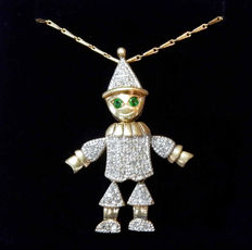 Necklace and pendant in gold, in the shape of an articulated jester puppet, inlaid with diamonds and emeralds