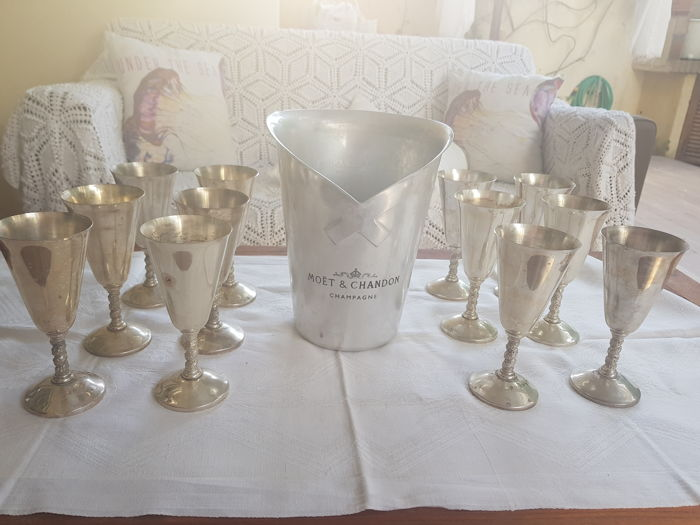 Moet & Chandon ice bucket and 12 silver plated wine glasses