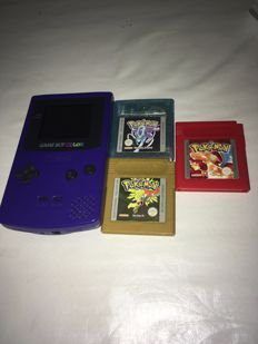 Gameboy Color including 3 pokemon games Crystal , Gold and Red.