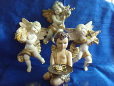 A lot with three Angels from the 1st half of the 20th century and one Angel from the 2nd half of the 20th century