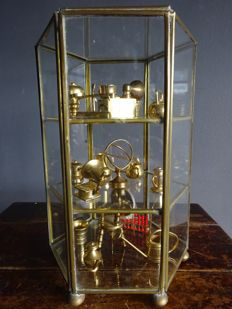 Vintage Glass Display Cabinet with 16 Copper Ornamental Pieces, 1960s