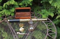 Maritime/Shipping items - extendable telescope in a mahogany chest - 2 compasses and a whistle.