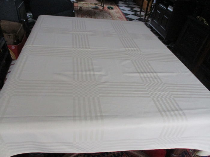 Yellow damask tablecloth with woven tile