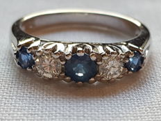 Gold ring set with sapphires and diamonds.