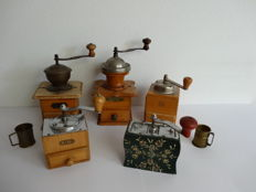 Five early 20th century wooden hand coffee Mills