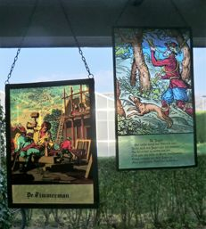 Two old Dutch stained glass SunCatchers: the Hunter and the Carpenter