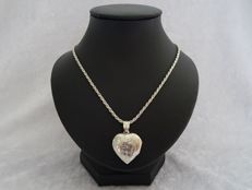 Silver hand stitched heart medal (21 x 30 x 8mm) with silver cord necklace - length 61 cm + matching ear clips.