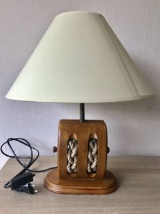 Table lamp in the shape of a wooden sailing boat pulley