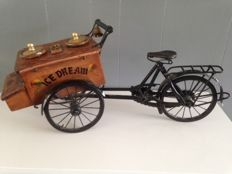 Nostalgic old wooden ice cream cart with bicycle (1940)