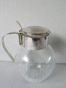 Wine/water jug with silver plated mount.